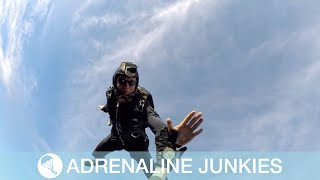 Skydivers High-Five While Jumping
