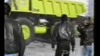 Massive Dump Truck Crushes Car