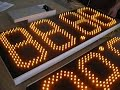 Табло АЗС с яркими светодиодами.The scoreboard of the gas station with bright LEDs