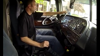 Shifting and jakebraking giant Peterbilt tractor trailer -inside cab view