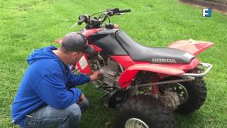 A man working on his quad