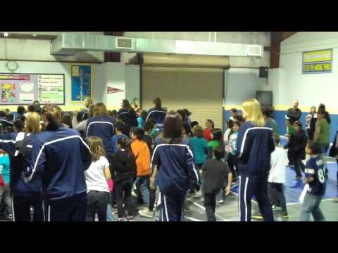 Augustana women's basketball team dancing with Carroll Bell Elementary School at the Elite Eight