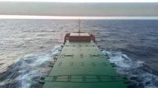 Timelapse Cargo Ship sailing at the Baltic Sea during the sunset HD