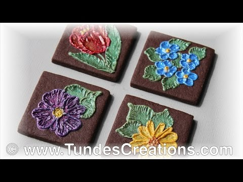 Chocolate square cookies with painted flowers