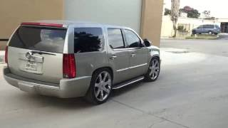 Escalade with roof-rack removed, wilwood brakes and drop kit