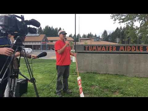 TEA President Tim Voie speaks to teachers on the picket line at Tumwater Middle School