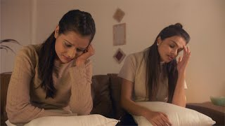 Attractive Indian girl talking to her sad teenage sister at home