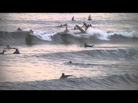 Alex Knost and Tommy Witt surf small Malibu