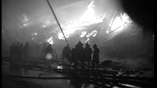 Firemen fight fire at a warehouse on dockside in New Orleans, Louisiana. HD Stock Footage