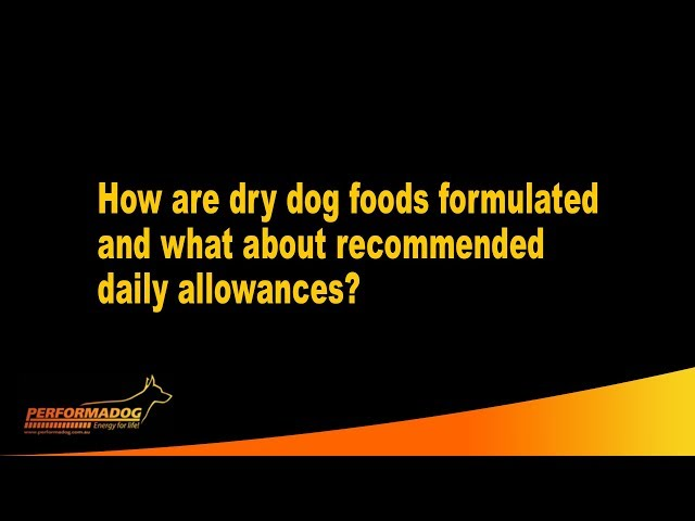 How are dry dog foods formulated and what about recommended daily allowances?
