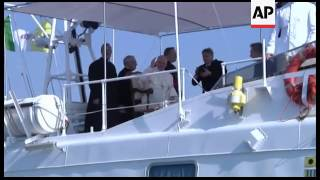 Italy - Boat carrying 162 immigrants from Eritrea arrives just as Pope landing /  Pope Francis greet