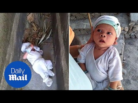 Baby boy rescued after being abandoned between tombs in graveyard
