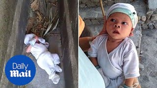 Baby boy rescued after being abandoned between tombs in graveyard - Daily Mail