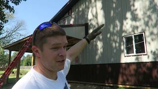Pole Barn Build Post Frame Metal Garaqe doors and Soffit EP.9