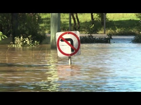 Flood waters in Australia's northeast reach all-time highs