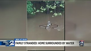 Family stranded: Home surrounded by water