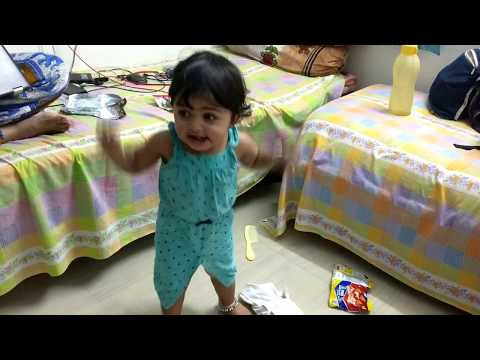 One year indian baby girl dancing with full energetic.