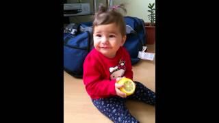Funny Babie eats lemon