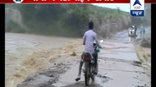 Biker washed away into river while crossing a flooded bridge