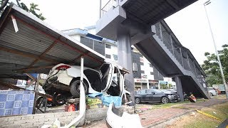 Flying Kia crashes into roadside food stall