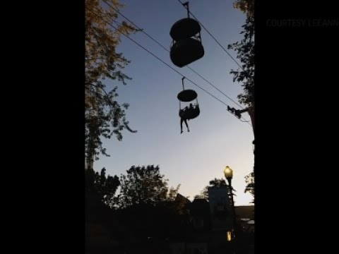 Raw: Crowd Catches Teen Falling from Park Ride