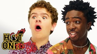Download Stranger Things' Caleb McLaughlin and Gaten Matarazzo Play Truth or Dab | Hot Ones Mp3 and Videos