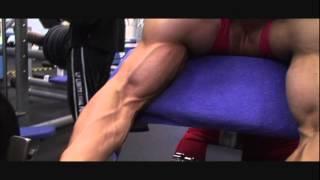 Huge FBB Alina Popa big biceps exercise & pose