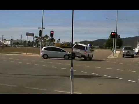 Police car crashes responding through red light - Townsville QLD