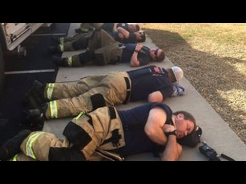 Firefighters Finally Rest By Sleeping On Sidewalk After Battling Wildfires