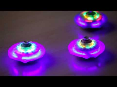 Light Up Spaceship Spinning Tops - HearthSong Toys