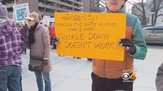 From youtube.com: Tax Plan Protesters {MID-213504}