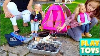 Cute girl playing with Dolls & Grilling MArshmallows smores