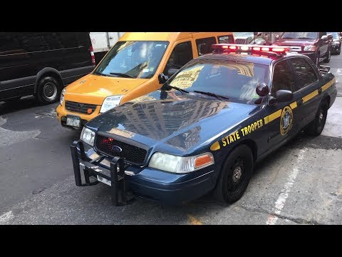 Several New York State Police Cars Responding To A Device In New York City