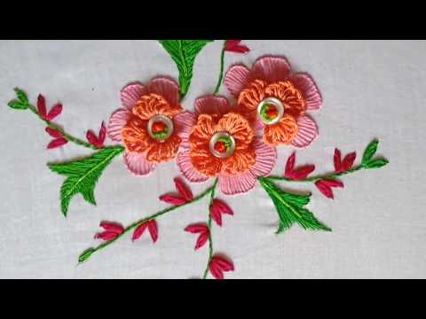 Hand embroidery. Brazilian embroidery design. Button art design.