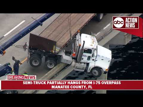 Semi-truck partially hangs from I-75 overpass in Manatee Co.