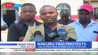 A digital cab driver in Nakuru storms police station in a quest to free their own