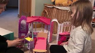 Caleb and Hannah playing with the Barbie house