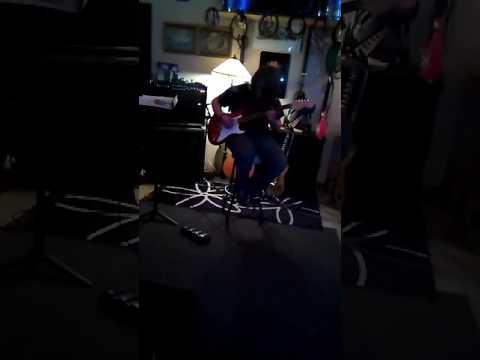 Damian Abraham and his guitar