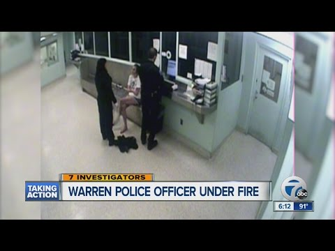 Warren police officer who cut off woman's weave under fire again for cutting detainee's hand