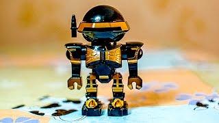 Робот, стреляющий волшебными дисками. The robot that shoots magical discs.