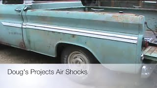 Replacing the rear shocks with air shocks on a Chevy C10 Truck