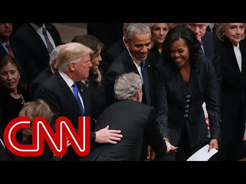 Michelle Obama, George W. Bush share warm moment at funeral