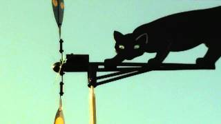 Black Cat Windmill Weathervane On A Windy Sunny Day..mov
