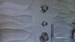Knoetze - Bathroom Installers- wet room with wavy tiles and Raindance Rainmaker Air shower