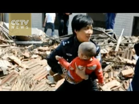 Shanghai building collapse: One woman and one child rescued