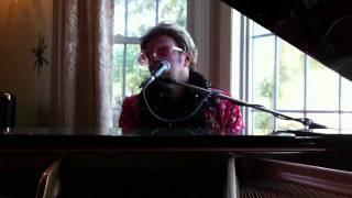 Bill Connors as Elton John