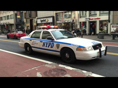NYPD ANTI-TERROR HERCULES SQUAD PATROLLING ON WEST 34TH ST. IN MIDTOWN, MANHATTAN, NEW YORK CITY.