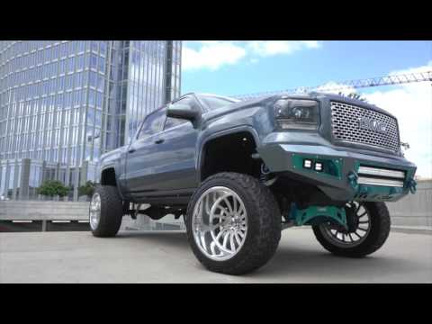 BEAUTIFUL TEAL BLUE GMC Sierra on 24x14s on 10 inch lift with king coil overs!