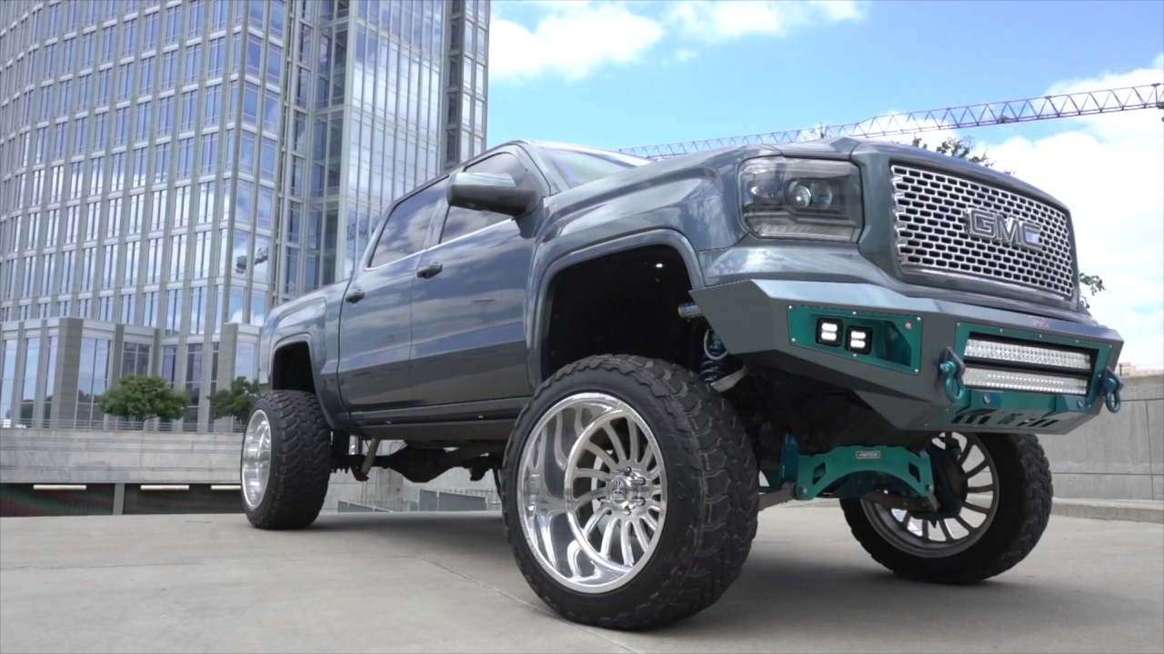 BEAUTIFUL TEAL BLUE GMC Sierra on 24x14s on 10 inch lift ...
