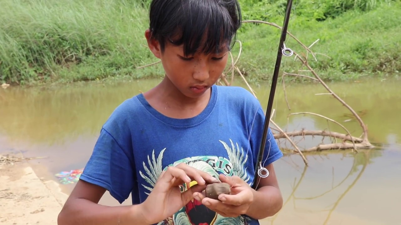 Amazing Two Boys Hook Big Fish At Small River In Cambodia